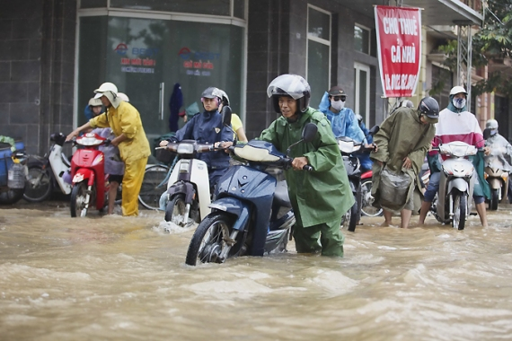 Typhoon Kai-Tak caused extensive flooding in northern Vietnam over the weekend [AFP]