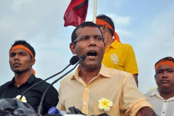 Former president Mohammed Nasheed says he was forced from office in a coup, but his opponents disagree [AFP]