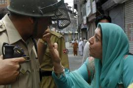 A woman argues with Indian police officers [Reuters]