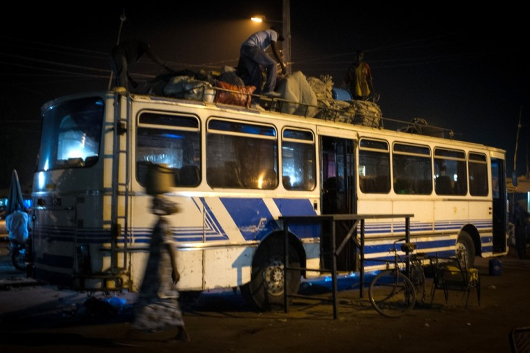 Men unload luggage from a bus arriving from Gao, a city now in the hands of rebels. Tens of thousands of people from Mali(***)s northern territories have fled and are now living in Bamako.
