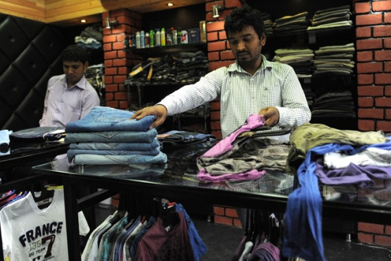 "Rajesh Shah (right) named his clothing store in Ahmedabad ""Hitler"", drawing ire from the Jewish community [AFP]"