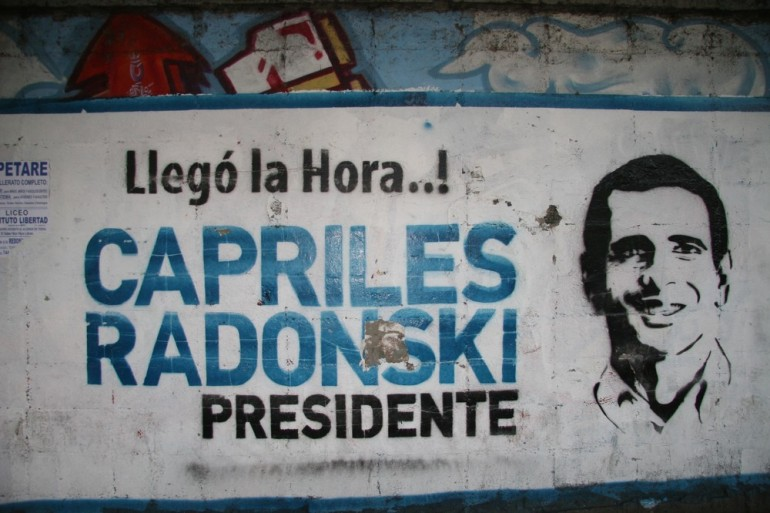 """Now is the time"" reads a stencil supporting opposition candidate Henrique Capriles."