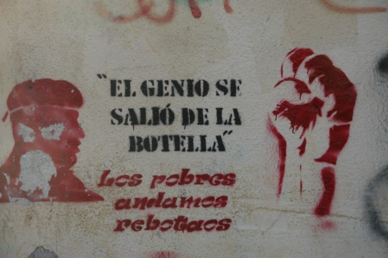 """The genie is out of the bottle"", reads this pro-government stencil. ""The poor are upset."""
