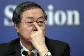 The IMF says People's Bank of China Governor Zhou Xiaochuan pulled out due to scheduling problems [Reuters]