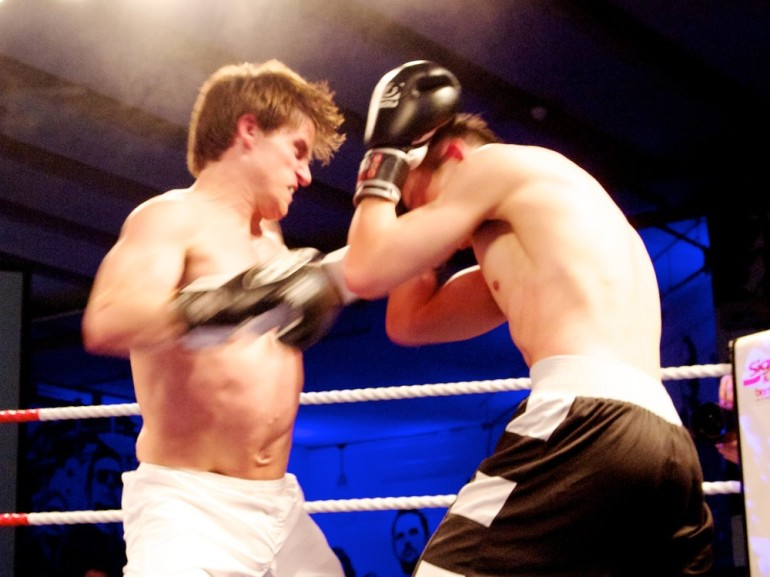 Mooney takes a left jab Woon in the (***)battle of the bankers(***), with Mooney working for Goldman Sachs and Woon for Citibank. [Al Jazeera/Jack Hochschild]