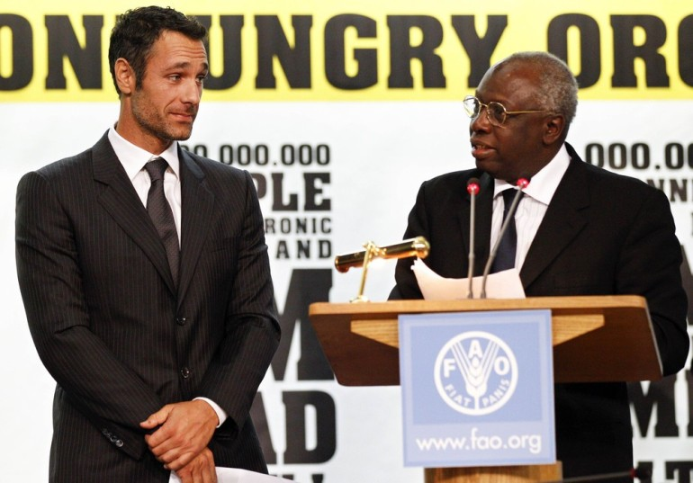 Former FAO Director-General Jacques Diouf, right, introduces Italian actor Raoul Bova during the celebrations of the World Food Day at the FAO headquarters in Rome. World Food Day is celebrated every year on October 16.