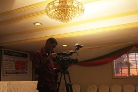 A videographer sets up his camera at a memorial service to honour the late Somali journalist Ali Sharmarke, assassinated by al-Shabab militants five years ago.