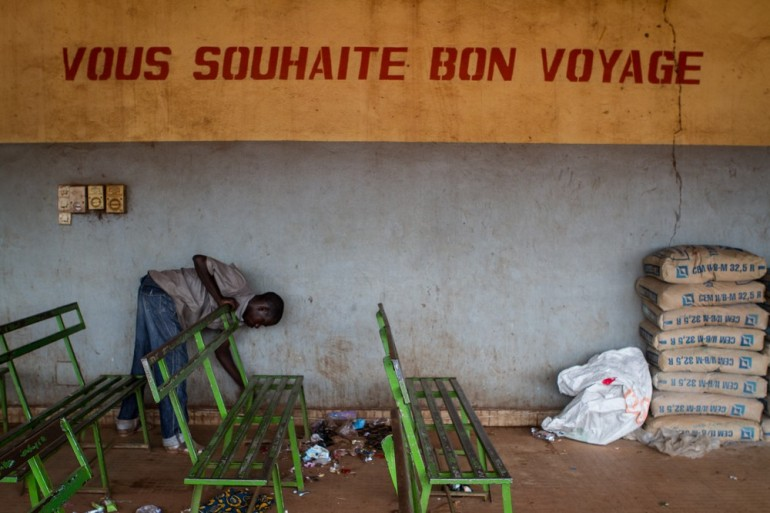 A man cleans the bus station in Bamako.
