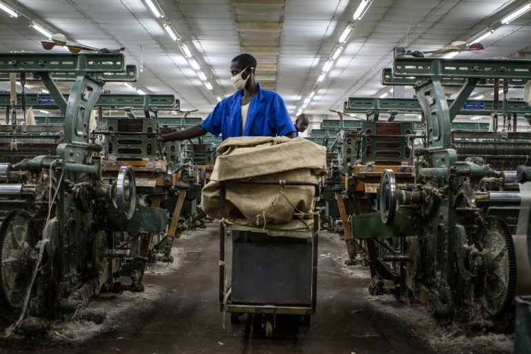 A worker collects finished products at a cotton processing plant in Segou.