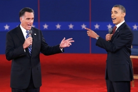 President Obama and Governor Romney spar during the second US presidential debate in New York [Reuters]