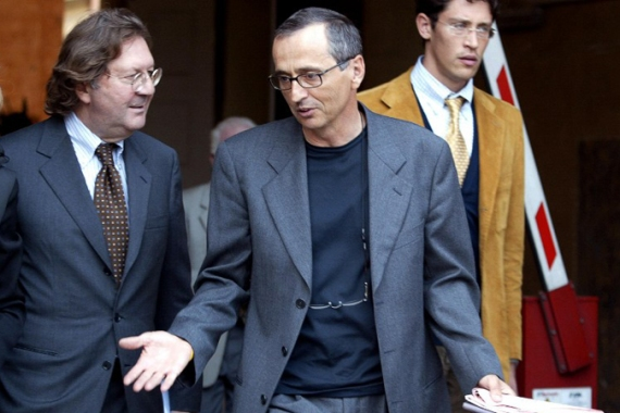 Disgraced doctor Michele Ferrari, pictured above centre in 2004, was named as a key figure in the USADA report last week [AFP]