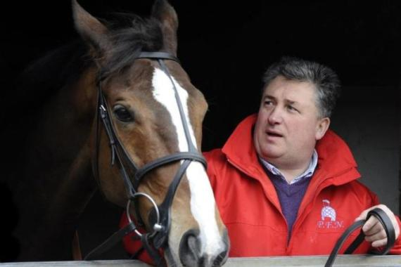 Trainer Paul Nicholls with Kauto Star, a star of racing who won four straight King George VI chases [AP]