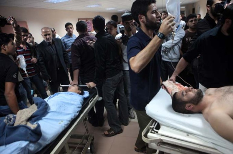 Shifa hospital in Gaza City struggles with the number of casualties following Israeli attacks.