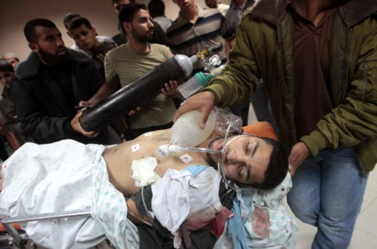 A wounded Palestinian is seen on a stretcher waiting to be transferred for surgery in Shifa hospital in Gaza City.