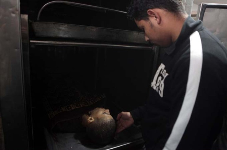 A Palestinian pays his respects to one of the victims of Israeli military attacks.