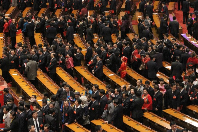 Chinese Communist Party delegates line up in order to leave the Great Hall of the People on the last day of its National Congress. The congress, which began on November 8, solidified the party(***)s once-in-a-decade leadership change.