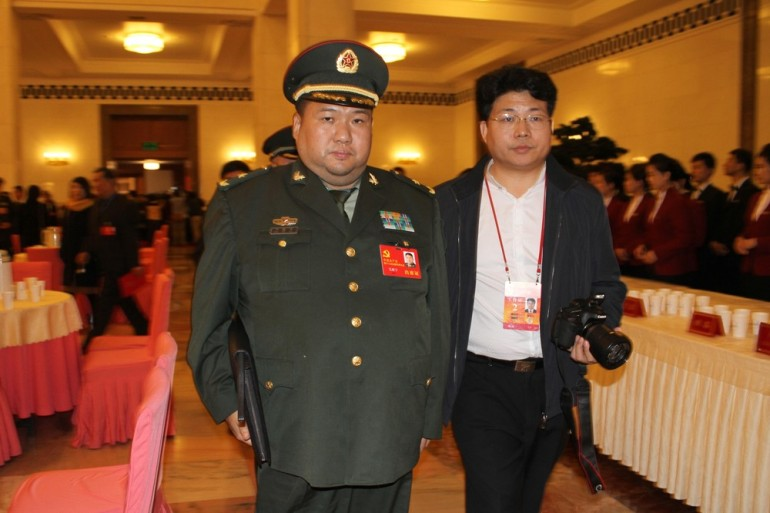Mao Zedong(***)s grandson Mao Xinyu, 42, leaves the National Congress. In 2010, he became China(***)s youngest major general.