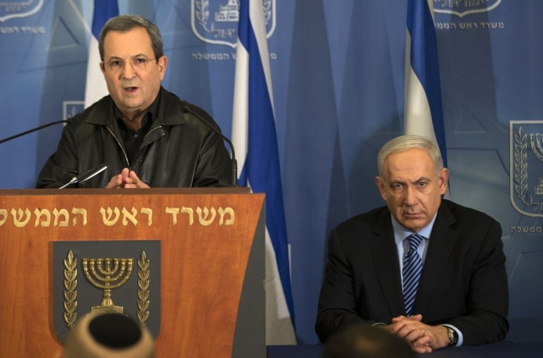 "Israeli Defense Minister Ehud Barak, left, and Prime Minister Binyamin Netanyahu address the media at the defence ministry in Tel Aviv on Wednesday. Israel sent a ""clear message"" to Hamas through the killing of its top military commander, and is ready to ""expand"" its operation in Gaza if necessary, Netanyahu said."