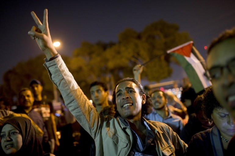 Egyptians chant slogans against the latest Israel airstrikes in Gaza during a protest in Cairo on Wednesday. Egypt has recalled its ambassador to Israel after an Israeli airstrike killed the military commander of Gaza(***)s ruling Hamas.