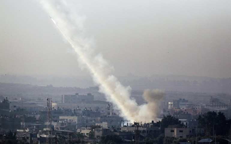 A rocket is seen after its launch from the northern Gaza Strip heading towards Israel. Armed groups had fired more than 250 rockets from Gaza as of Thursday afternoon, according to Israeli authorities.