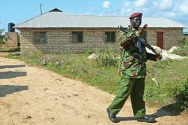 A Kenyan police officer guards a house where two suspects died after a grenade attack near Mombasa [AFP]