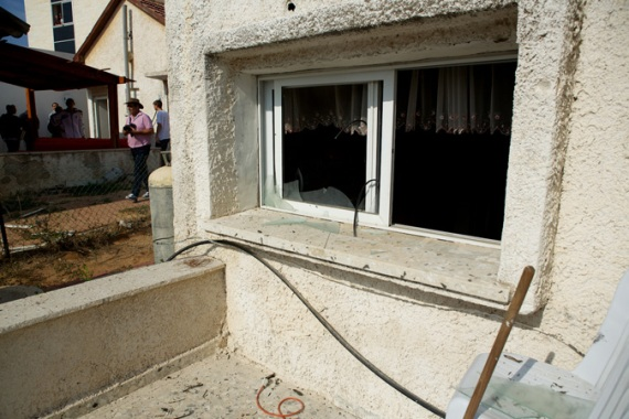 A rocket exploded at this house in Sderot on Tuesday, causing no injuries [Gregg Carlstrom/Al Jazeera]