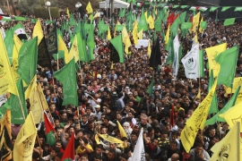 Thousands of residents gathered to celebrate the ceasefire, waving flags of various Palestinian factions [Reuters]