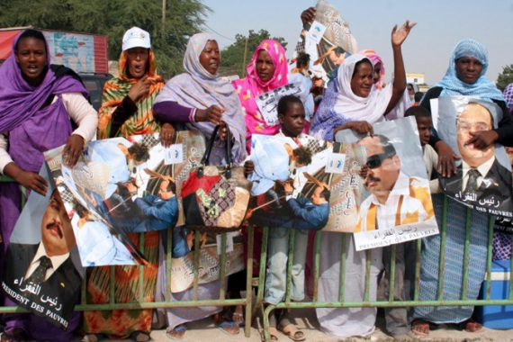 Thousands of Mauritanians lined the streets from the airport waiting to welcome the president [AFP]