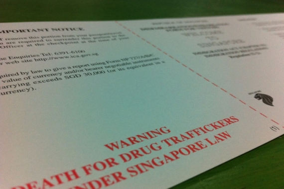 A visitor arrival form to Singapore warns of the death penalty for peddling drugs [Heather Tan/Al Jazeera]