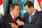 Hugo Chavez (left) has chosen to steer the Syrian-Venezuelan community into his own corner while jettisoning any notion of a human-rights oriented foreign policy [EPA]