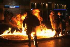 Petrol bombs exploded next to riot police during the demonstration in central Athens [Reuters]