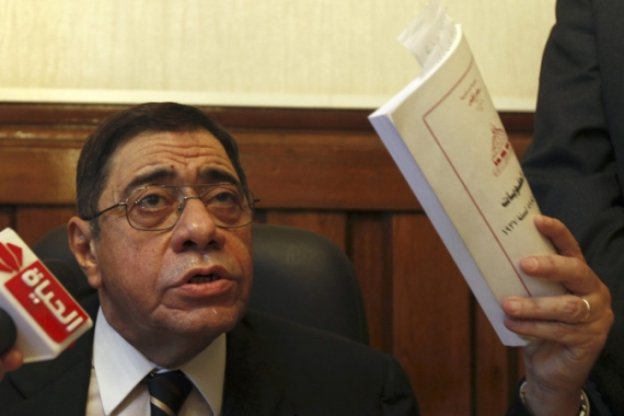 Sacked prosecutor general Mahmoud rejected Morsi's decree, saying he was prepared to challenge it in court [Reuters]