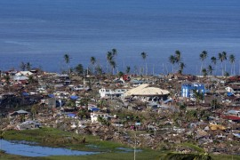 The town of Boston, in the southern Philippines(***) Compostela Valley province, was devastated by Typhoon Bopha.