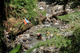 Children search for gold left over from small-scale mining projects in the Compostela Valley, located in the Davao Region of Mindanao in the southern Philippines. About one-third of Filipinos live under the poverty line, and many experience underemployment.