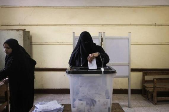 Egypt's opposition cried fraud in the first round of a divisive referendum on a new constitution [AFP]