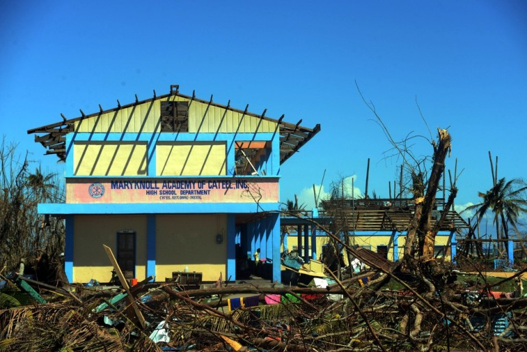 A wrecked school in Cateel, a town that was devastated by the typhoon(***)s strong winds. The storm destroyed thousands of homes, and many families are now living in cramped, temporary accommodations.