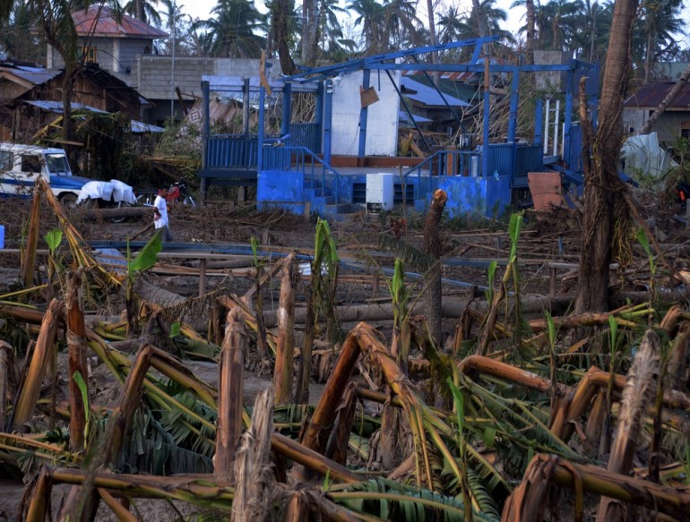 Toppled banana trees and destroyed houses abound in New Bataan town in Compostela Valley.
