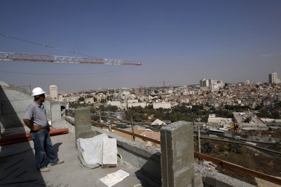 New apartment buildings are mushrooming up across Israel, sparking debates over community identity [Reuters]