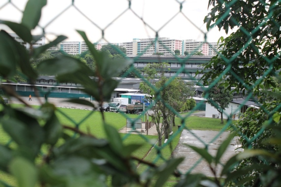 The workers' dormitory in the Serangoon Gardens estate is closed off from public view [Heather Tan/Al Jazeera]