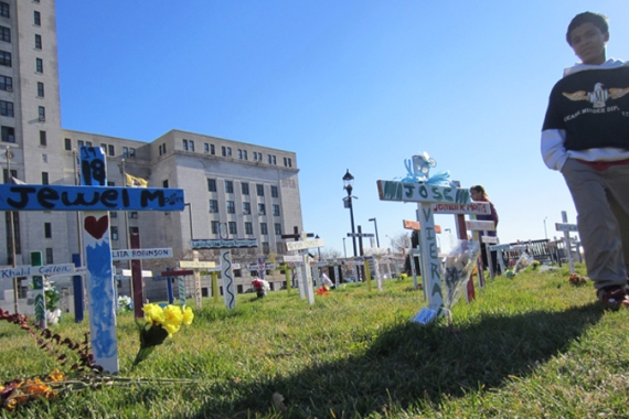 Dozens of crosses are placed at Camden City Hall as the homicide rate surges [Steve Patrick Ercolani/Al Jazeera]