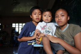 The Saigod children lost their parents and 10 other family members to Bopha [Jeoffrey Maitem/Al Jazeera]