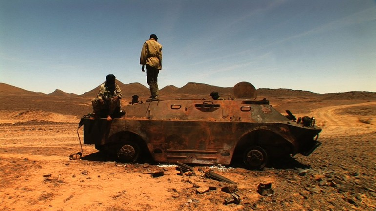 Burned Mali Army tank, Tinzouatene.  Defeated, Mali began relying more on ethnic paramilitaries to fight Tuareg rebellion.