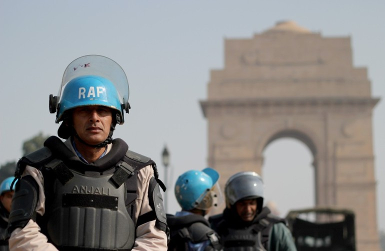Members of the country(***)s Rapid Action Force stood guard at the India Gate monument after Delhi police locked down areas around Rajpath, where violent protests took place last week.