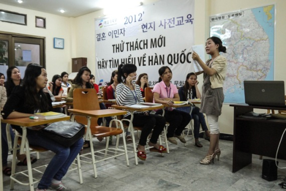 Pham Que Nguyen teaches a Korean culture class to Vietnamese wives in Ho Chi Minh City [Lien Hoang/Al Jazeera]