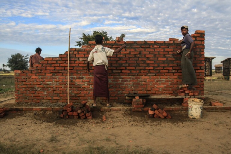 Bricklayers build a shelter for Internally Displaced People (IDPs) at the Ohn Taw Gyi site near the Rakhine capital, Sittwe.