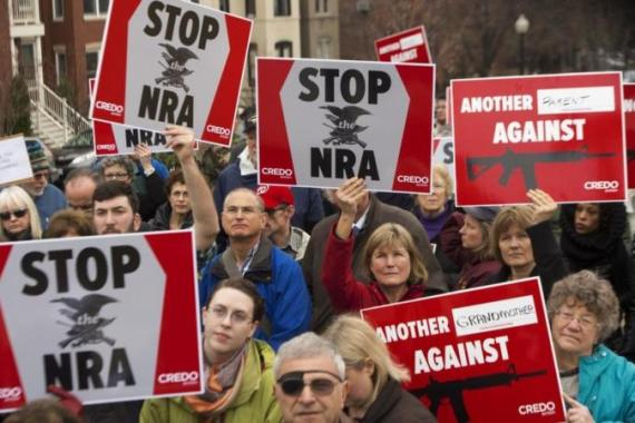 Many Americans support new gun restrictions, but will Obama get tough on the NRA? [AFP]