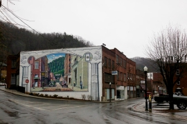 A mural of Welch in its heyday stands in contrast to the town's bleak situation today [Roopa Gogineni/Al Jazeera]