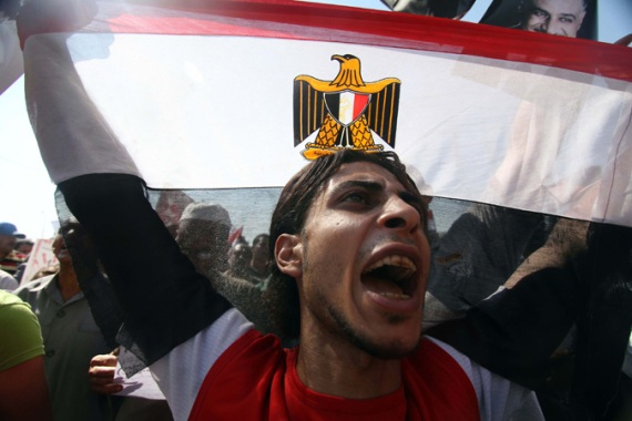 Election comes at a time when the country is deeply divided between Morsi's supporters and secular opposition [EPA]