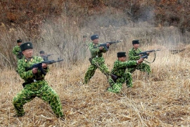 Korea's official news agency released an undated photo of a military drill as Kim Jung-Un threatened Baengnyeong [AFP]