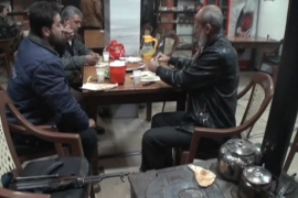 Syria restaurant soldiers on